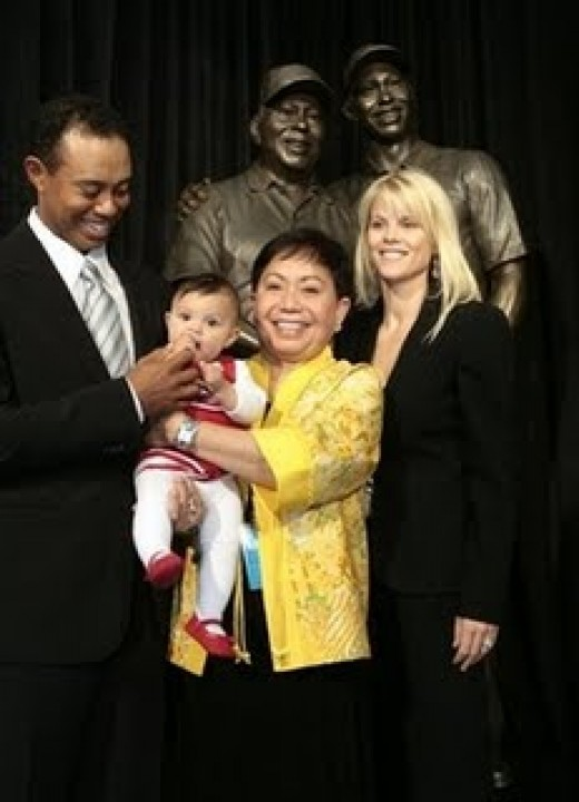 Tiger with his Mom and family at dedication of the stature of his father at the Tiger Woods Foundation