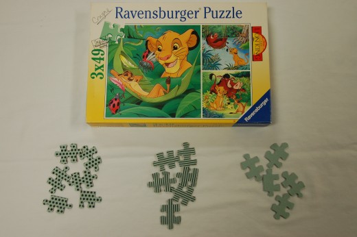 3 puzzles with 3 different markings on the back.