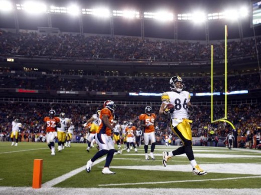 Pittsburgh Steelers wide receiver Hines Ward celebrates after catching a pass for a touchdown against the Denver Broncos during the fourth quarter of the Steelers' 28-10 victory in an NFL football game Monday, Nov. 9, 2009, in Denver. (AP Photo/David