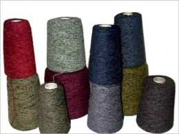 Dyed Yarn on Cones used for Weft in Weaving Machines.