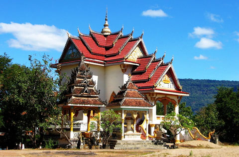 A temple or wat in Pakse, Laos where my father grew up.  I'd like very much to donate one of my own.  My father already has.
