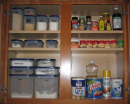 Storage containers for baking ingredients keep cupboard organized.