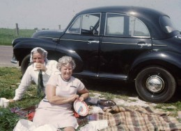 My parents picniccing with my Uncle Jeff Keen's Morris Minor behind them
