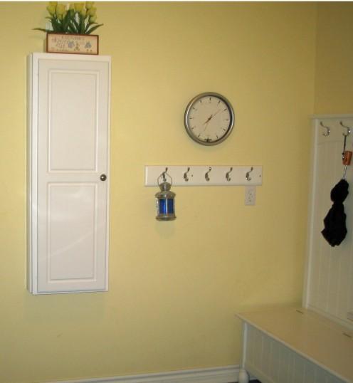 coat hooks and clock