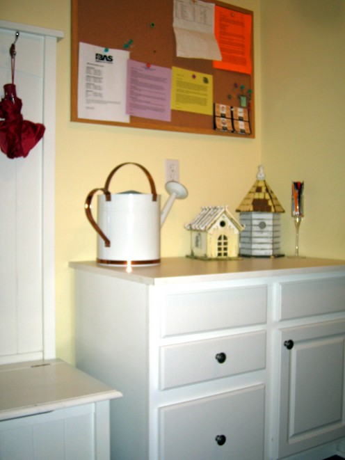 storage cabinet with drawers, bulletin board