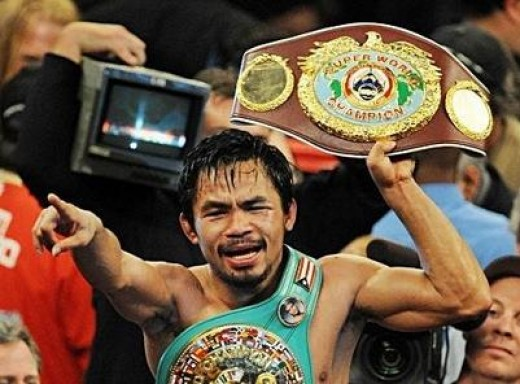 Manny Pacquiao raising the WBC welterweight championship belt he wrested from Cotto.
