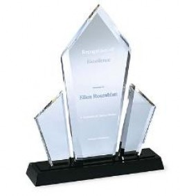 Three striking pinnacles of brilliant acrylic make a dazzling visual statement that is both eloquent and impressive. These employee awards are designed to distinguish only the highest forms of achievement. Black base has gold-tone inserts which refle