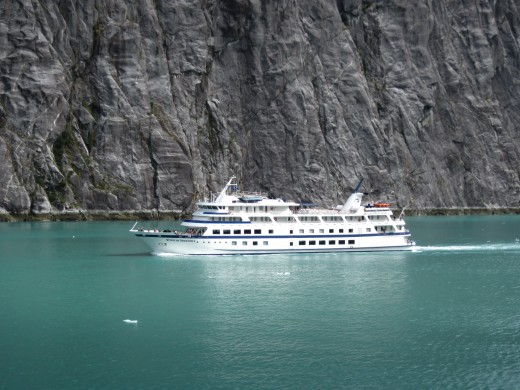 A cruise ship making its way out of the fjord.
