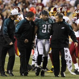 Brian Westbrook being helped off the field after sustaining a major concussion against the Redskins