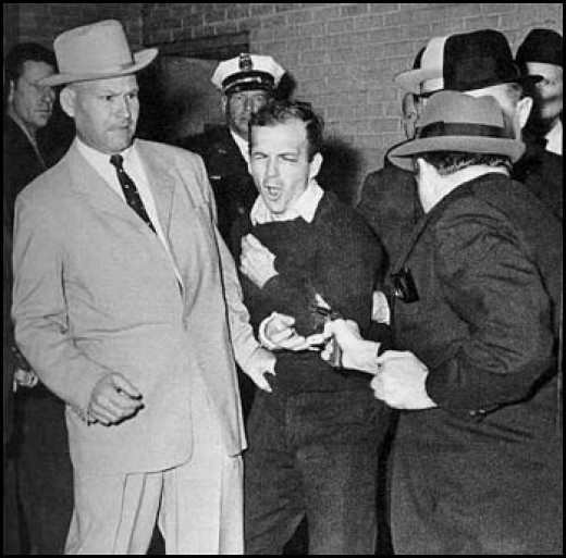Here is a photo of Jack Ruby as he shot Oswald in the garage of the Dallas Police Station.