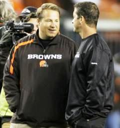 Cleveland Browns coach Eric Mangini, left, talks with Baltimore Ravens coach John Harbaugh  Nov. 16, 2009, in Cleveland. (AP Photo/Mark Duncan)