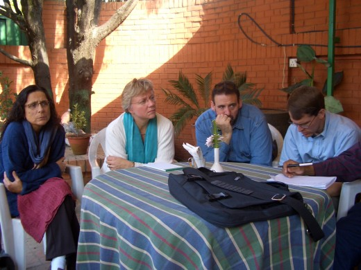 Team members listening intently to church leaders in Kathmandu.