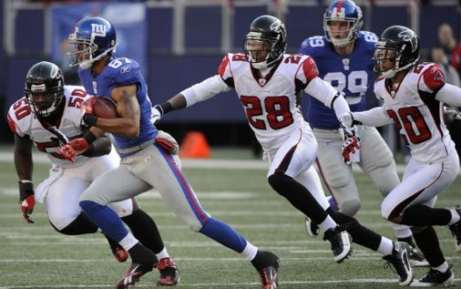 New York Giants wide receiver Domenik Hixon (87) runs for a first down against Atlanta Falcons linebacker Curtis Lofton (50), safety Thomas DeCoud (28) and cornerback Brent Grimes (20) during the first quarter of an NFL football game, Sunday, Nov. 22