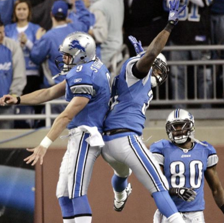 Detroit Lions quarterback Matthew Stafford (9) and running back Kevin Smith, front right, celebrate Smith's 25-yard touchdown-reception against the Cleveland Brown in the second quarter of an NFL football game Sunday, Nov. 22, 2009, in Detroit. (AP P
