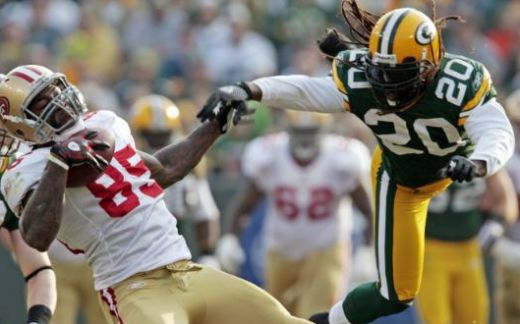 San Francisco 49ers' Vernon Davis (85) catches a pass in front of Green Bay Packers' Atari Bigby (20) during the second half of an NFL football game Sunday, Nov. 22, 2009, in Green Bay, Wis. The Packers won 30-24. (AP Photo/Mike Roemer)