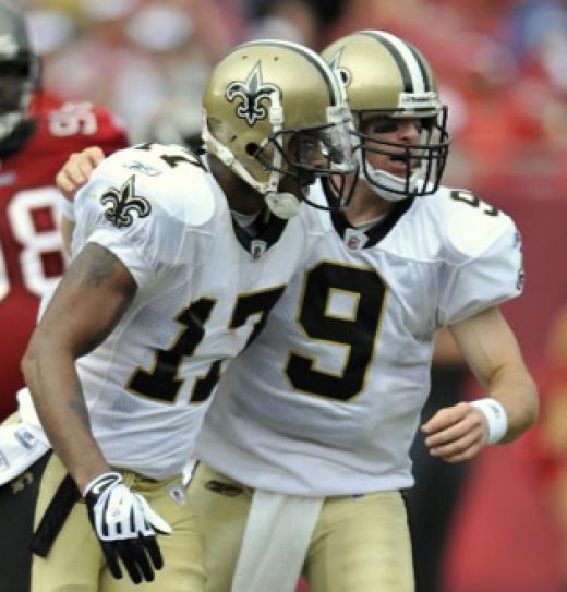 New Orleans Saints quarterback Drew Brees (9) celebrates with Robert Meachem after Meachem caught a second quarter touchdown pass from Brees during an NFL football game against the Tampa Bay Buccaneers Sunday Nov. 22, 2009 in Tampa, Fla. (AP Photo/St