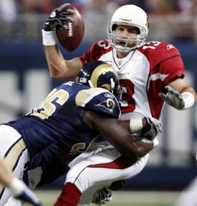 Arizona Cardinals quarterback Kurt Warner, right, is sacked for a seven-yard loss by St. Louis Rams defensive end James Hall during the first quarter of an NFL football game Sunday, Nov. 22, 2009, in St. Louis. (AP Photo/Tom Gannam)