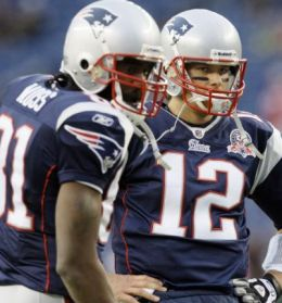 New England Patriots wide receiver Randy Moss (81) and quarterback Tom Brady (12) watch the New York Jets warm up before an NFL football game in Foxborough, Mass., Sunday Nov. 22, 2009. (AP Photo/Elise Amendola)