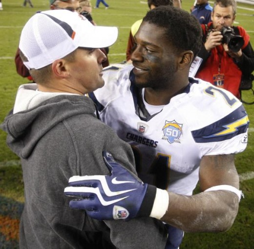 San Diego Chargers' LaDainian Tomlinson, right, chats with Denver Broncos head coach Josh McDaniels after an NFL football game, Sunday, Nov. 22, 2009, in Denver. The Chargers defeated the Broncos 32-3. (AP Photo/Jack Dempsey)