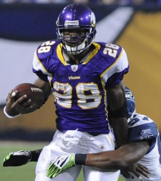 Minnesota Vikings running back Adrian Peterson, left, gains yardage on a pass-play before being brought down by Seattle Seahawks linebacker David Hawthorne in an NFL football game Sunday, Nov. 22, 2009, in Minneapolis. (AP Photo/Jim Mone)
