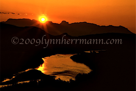 Sunsets over the Chisos Mountains can be spectacular from along the Rio Grande River.