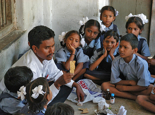 School Kids Sitting on Floor.