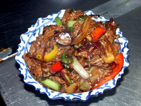 For a Thai version, add red and yellow bell peppers, some other vegetables, like bok choy, and some hot sauce or some spicy hot oil to the cooking process. (Public domain.)