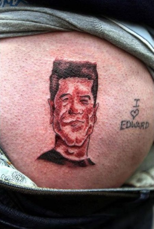 Camel Toe Tattoo design anyone? This one looks like Simon Cowell from