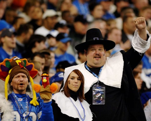 Detroit Lions fans celebrating the Thanksgiving Day game.  Photo by Al Messerschmidt/Getty Images