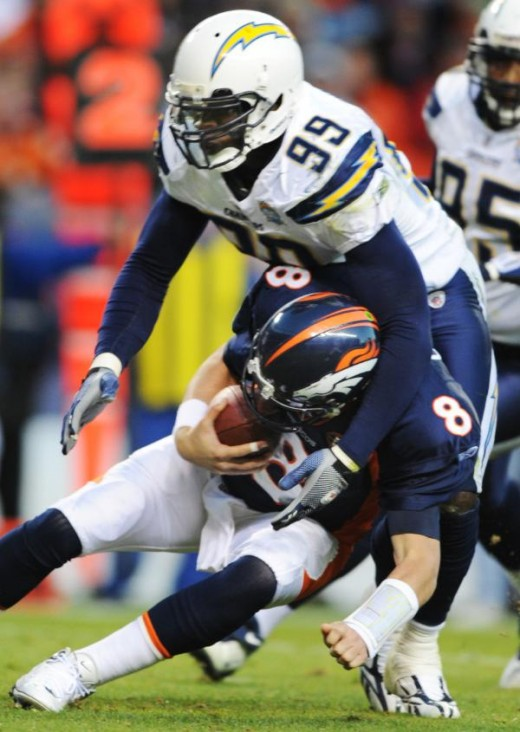 Denver Broncos' Kyle Orton (8) is sacked by San Diego Chargers' Kevin Burnett (99) during the fourth quarter of an NFL football game, Sunday, Nov. 22, 2009, in Denver. (AP Photo/Chris Schneider)