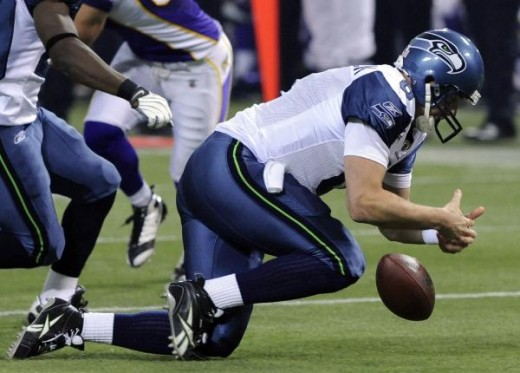 Matt Hasselbeck fumbles and then recovers the snap for a loss in the first quarter. AP Photo/Jim Mone