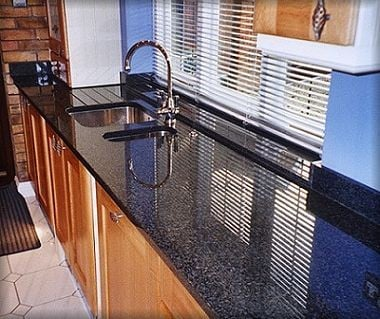 Bon Accord granite worktop with 1½ bowls, polished cut-out and drainage grooves with window ledge from Granite Worktops UK Ltd