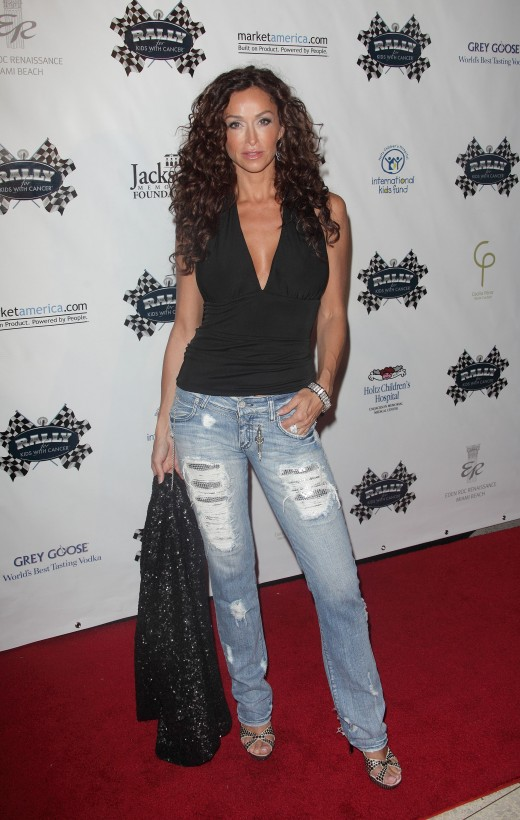 Sofia Milos in tight and torn jeans and high heels