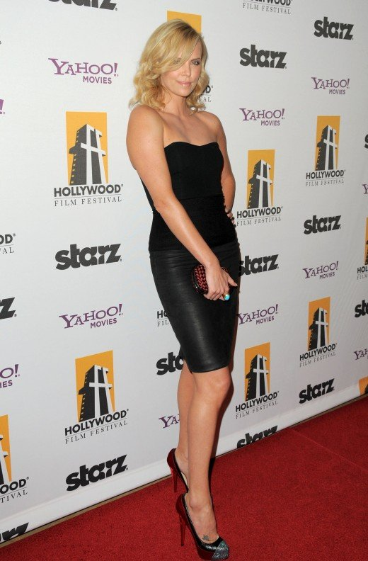 Charlize Theron arrives at the 13th Annual Hollywood Awards Gala in a black strapless dress and high heels