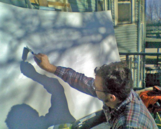 Here is artist Ben Zoltak preparing a custom stretched canvas painting with gesso.