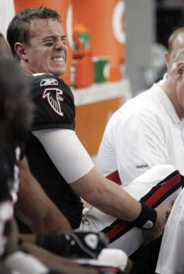 Atlanta Falcons quarterback Matt Ryan, left, reacts as training staff attend to his injured foot in the first quarter of an NFL football game against the Tampa Bay Bucaneers in Atlanta, Sunday, Nov. 29, 2009. (AP Photo/John Bazemore)