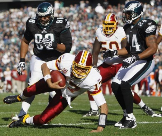Washington Redskins' Jason Campbell (17) dives for a touchdown as Philadelphia Eagles' Mike Patterson (98) and Sheldon Brown (24) defend in the first half of an NFL football game, Sunday, Nov. 29, 2009, in Philadelphia. (AP Photo/Matt Slocum)