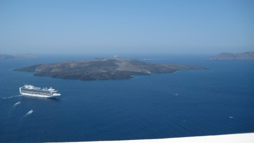 the water of the Caldera, a cruise liner and Nea Kameni, the volcano island.