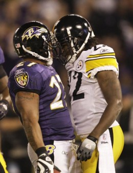 Baltimore Ravens running back Ray Rice, left, and Pittsburgh Steelers cornerback William Gay, right, talk after Rice carried the play during the first half of an NFL football game, Sunday, Nov. 29, 2009, in Baltimore. (AP Photo/Rob Carr)