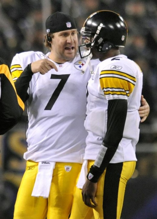 Pittsburgh Steelers Ben Roethlisberger (7) talks with starting quarterback Dennis Dixon, right, during the first half of an NFL football game against the Baltimore Ravens, Sunday, Nov. 29, 2009, in Baltimore. Roethlisberger did not start the game due