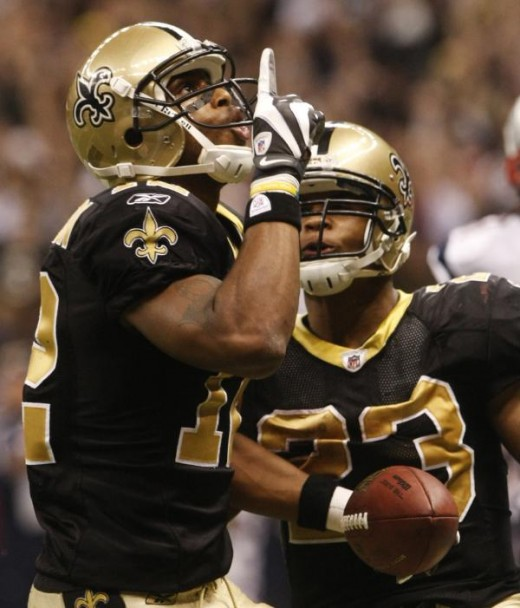 Marques Colston, left, celebrates his 20-yard touchdown pass with Pierre Thomas during the fourth quarter of an NFL football game against the New England Patriots, Monday, Nov. 30, 2009, in New Orleans. (AP Photo/Dave Martin)