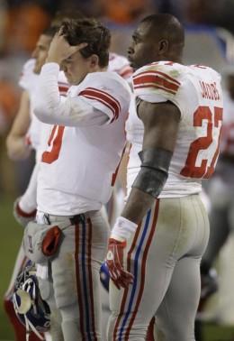 Brandon Jacobs (27) talks with quarterback Eli Manning (10) during the fourth quarter of an NFL football game against the Denver Broncos in Denver, Thursday, Nov. 26, 2009. Denver won 26-6. (AP Photo/Darron Cummings)