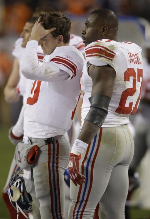Brandon Jacobs (27) talks with quarterback Eli Manning (10) during the fourth quarter of an NFL football game against the Denver Broncos in Denver, Thursday, Nov. 26, 2009. Denver won 26-6. (AP Photo/Darron Cummings)