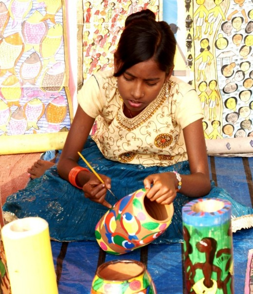 Starting early : a young girl from the Potua community at her art-work.