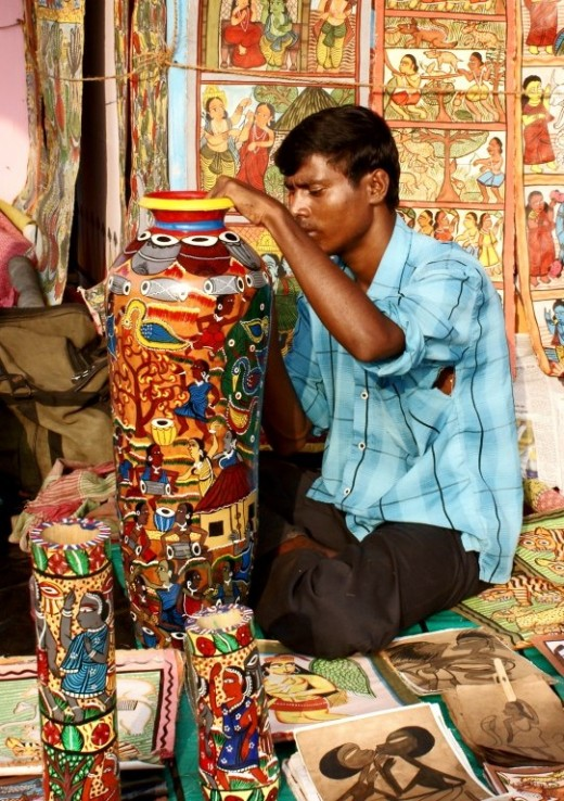 A young boy from the Potua community at his art-work.