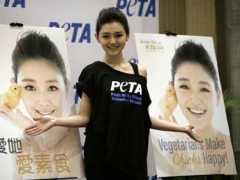 """English: """"Vegetarians make chicks happy!""""  Chinese: """"Love her, love vegetarianism."""""""