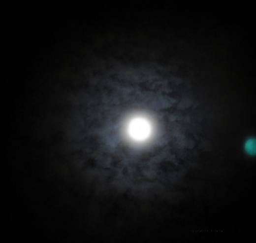 A halo around the moon portends precipitation in the days ahead.