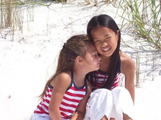 Lexi and Madison on a Florida gulf beach.