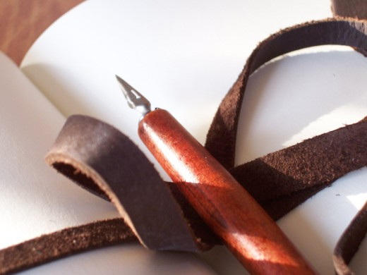 A quill and paper, just like the old greats used to do it.  (Photo by Stephantasy)