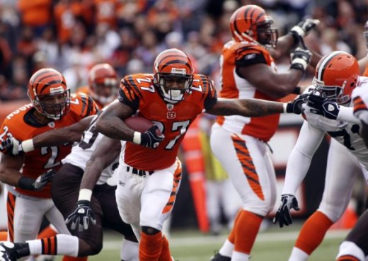 Larry Johnson (27) breaks through the line during the first half of their NFL football game against the Cleveland Browns in Cincinnati, Sunday, Nov. 29, 2009. (AP Photo/Tony Tribble)